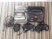 sega megadrive 2 with few games all wires and 2 pads