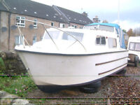 Norman 23ft Cabin Cruiser with 70hp Evinrude Outboard Engine.