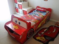 Disney Cars bed and matching canvas, rug, light shade, and storage unit