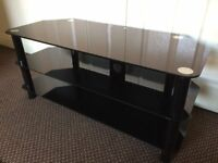TV STAND BLACK GLASS, SCRATCH LESS GLASS CLEAN CONDITION, SIZE Width 105cm, Deep 45cm, Height 47cm.