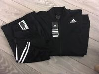 Adidas tracksuit new and authentic