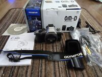 Olympus E-M5 Mark 1, Silver, excellent, boxed plus grip available, under 5000 actuations.