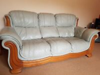 Leather three seater sofa with two matching arm chairs and footstall with storage space
