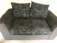3 and 2 seater Black sofa with Black floral Pattern.