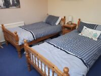 Set of solid pine single twin beds plus mattresses as optional extra