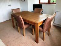 Polished oak dining table, 1.6m x 0.9m.