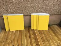 Vintage retro bright yellow Formica kitchen cupboard doors.