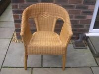 An adult wicker chair.
