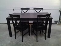 New Black dining table and 4 black cross back chairs. Bargain Boxed. Can deliver.