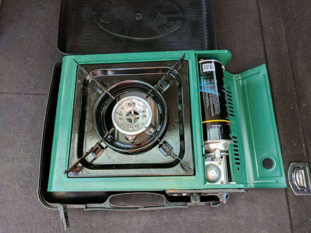 Camping stove with gas suitcase stylein Poole, DorsetGumtree - Camping stove with a few gas bottles. Great condition. Hardly used. £5