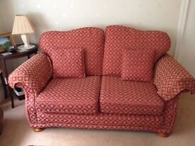 Sofa in red with gold delineated flowers.