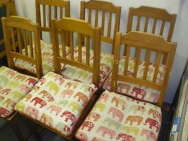 6 WOODEN CHAIRS C/W ELEPHANT CUSHIONS