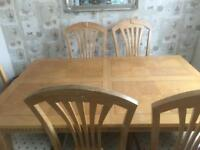 Solid oak dining room table with 5 chairs