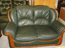Green leather two seater sofa and two armchairs