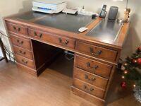 Large elegant mahogany pedestal desk with black leather & ornate gilt tooled panels