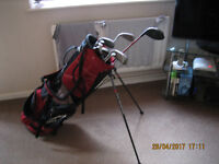 set of adult gallaway clubs and bag and a driver