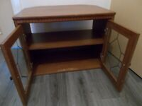 CORNER TV STAND/UNIT WITH GLASS DOORS FOR SALE