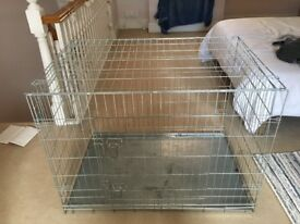 X large dog crate 104cm x 78cm . Two openings . Used for Labrador. Very sturdy .