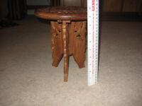 Ornately carved wooden stool