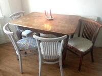 Vintage solid wood dining table with four vintage style chairs