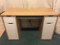 Nearly new desk with two cupboards and two drawers.