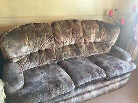 Three piece sofa and puffet £100