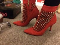 Zara Red heels/boots with gold studs.size 5