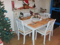 Hand painted dining table and four chairs