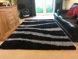 Black and grey / silver deep pile rug
