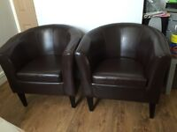 2 brown leather tub chairs