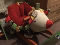 Nearly new hedgehog rocker with crinkle tags.