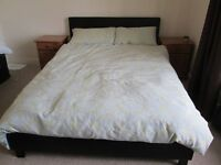 Double bed in black leather effect