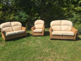 Rattan Conservatory Sofas / Settees & Arm Chair plus extra new cushions.