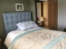 Bensons 3/4 Divan storage bed with classic buttoned headboard.