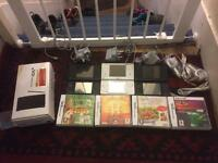 3 Nintendo DSi with accessories