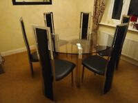 Round Glass Table and Six Chairs