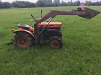 Kubota B6000 Tractor. With rotavator and front loading bucket.