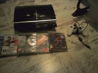 playstation 3 with all wires 1 pad and 4 games all working but no box