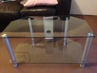 Glass TV stand for sale.