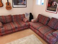 2x large Sofas with red or cream fabric.