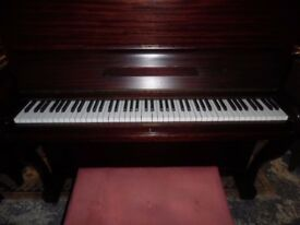 upright piano by berry -- also required--