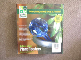 Four glass self-watering bulbs for house plants - as new in box