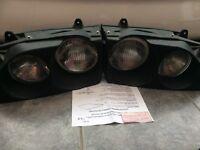 BRAND NEW: Morette quad lights, bought for 1993 Ford Escort, Mark 5.