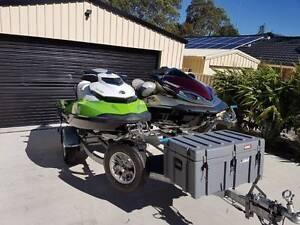 Kawasaki and seadoo Jetskis on tandem trailer Springfield Ipswich City Preview