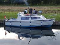 Mayland 20 cabin cruiser with trailer.