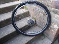 complete rear mountain bike wheel , 7 speed