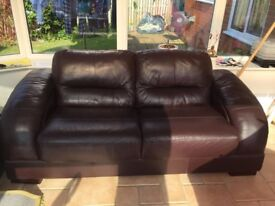 Pair of brown leather sofas.