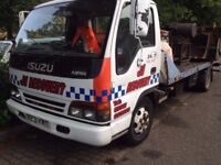 Isuzu NPR recovery truck with tilt and slide and spec lift.