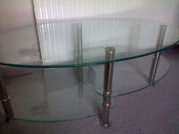 Glass and Chrome Oval Coffee Table. Very Good Condition.