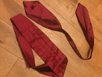 Red cummerbund and cravat
